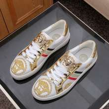white and gold versace shoes